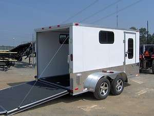 Finished interior enclosed motorcycle cargo trailer ramp door